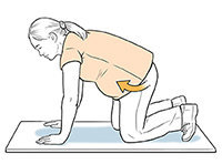 Pregnant woman on all fours doing pelvic tilt exercise.