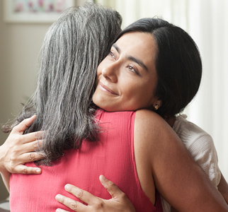Close-up of two women hugging
