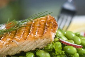Broiled salmon with herbs on bed of edamame.