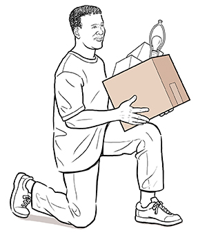 Side view of man on one knee lifting box.
