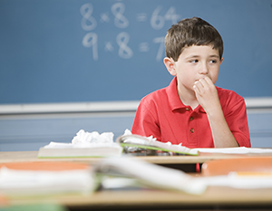 Boy not paying attention in classroom.