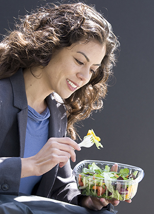 Woman eating salad.